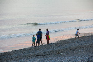 Adults and children playing on a beach